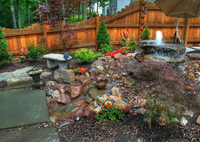 Water Feature with stone bench